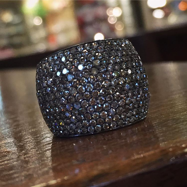 Stop by our Summit location to see this stunning pavé diamond 18 karat black gold ring! #pavediamonds #blackgold #diamondring #stunning #sparkle #brombergsjewelry #18k